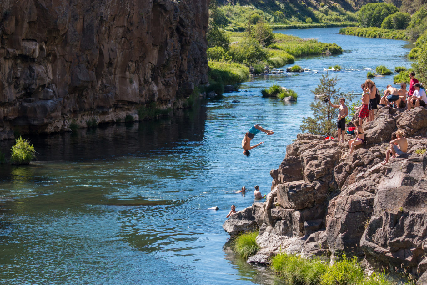Victor Arias backflips into the river in Oregon - Photograph by Erick Garcia